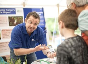 Dr Davide Bulgarelli explains the power of plants to a young visitor