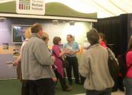 Photograph of a busy James Hutton Institute stand at RHS 2011