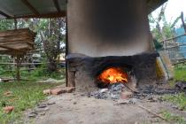 Heating the drier with a wood fire