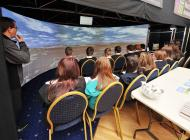 Young residents viewing Oban Bay from McCaigs Tower in virtual relity model in V