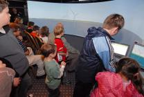 Young audience member navigating virtual tour of Aberdeen Bay windfarm proposal
