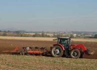 Photograph of a tractor ploughing a field