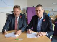 Prof Campbell and Mr Relaes signed the document