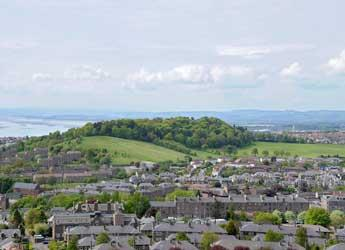 View of Dundee showing housing and green space from the Law Hill
