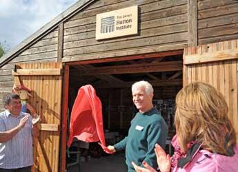 Iain Gordon unveils the sign at the Hutton Hut
