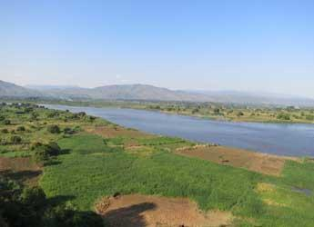 River in Malawi surrounded by fields