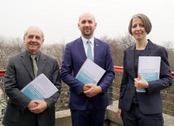 The report was launched by Migration Minister Ben Macpherson (centre)