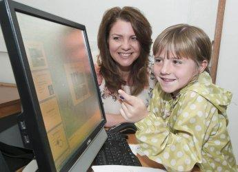Heather Reid and budding TV weather forecaster 7 year-old Rebecca Cruickshanks