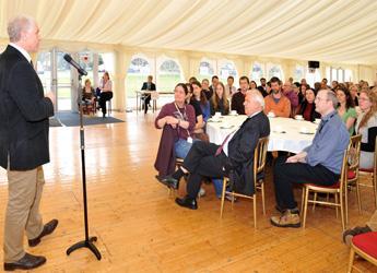 Iain Gordon addressing staff in Aberdeen