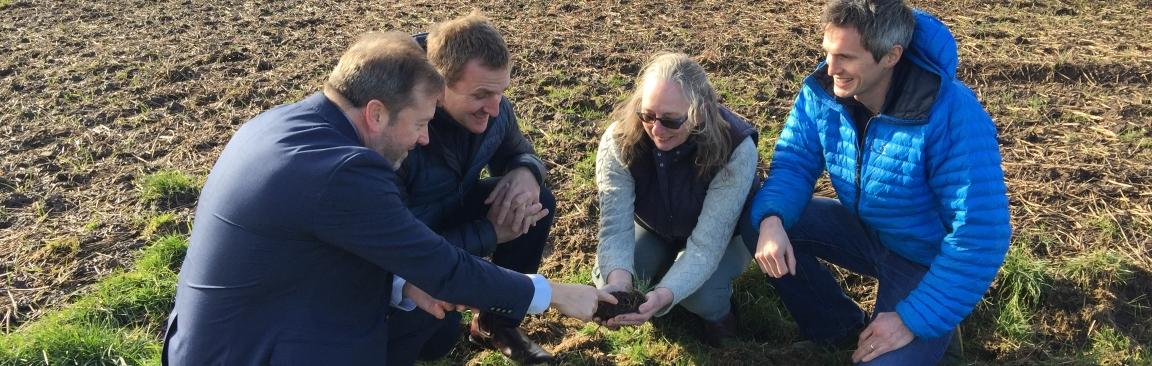 Colin Campbell, Matt Gorman, Helaina Black and Stewart Arbuckle look at soil