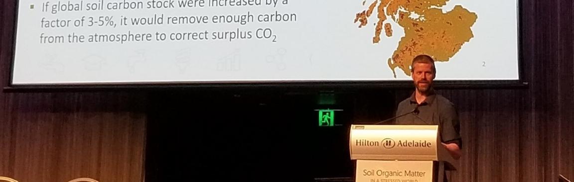 Matt Aitkenhead speaks at the 7th SOM symposium in Adelaide, Australia