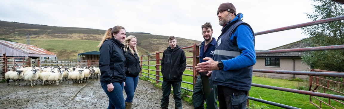 Donald Barrie (r), Glensaugh farm manager, speaks to SRUC students