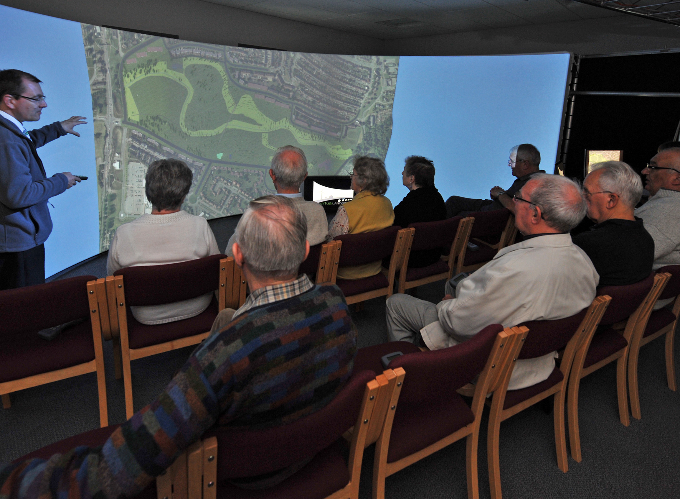 Community group interpreting aerial image of Finlathen Park Dundee