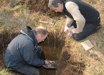 Image showing soil surveyors carrying out work in a soil profile pit