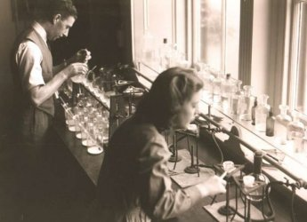 Historical photograph of scientists in the lab at the Macaulay Institute