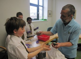 Kenny Hood showing the pupils from RGC how to handle the Tiger worms.