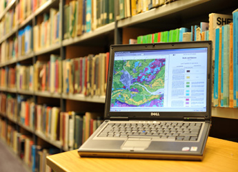 Photograph of a laptop computer in a library