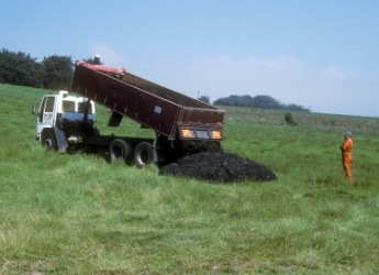 Photograph of a lorry delivering sludge to the field site