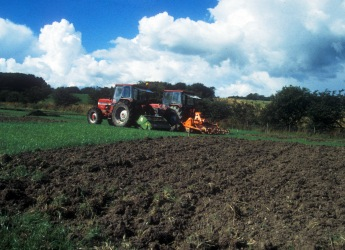 Photograph showing a tractor applying sewage sludge