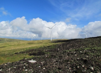 Photograph of a wind turbine and peat bog