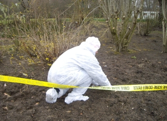 Photograph of soil forensic samples being collected (courtesy Lorna Dawson)