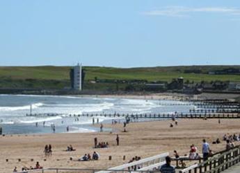 Photograph looking along Aberdeen beach