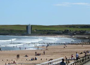 Photograph looking along Aberdeen beach