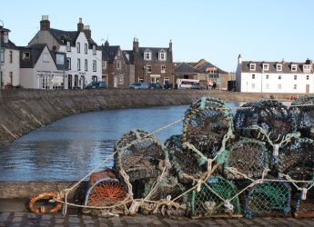 Photograph looking across the inner harbour at Stonehaven
