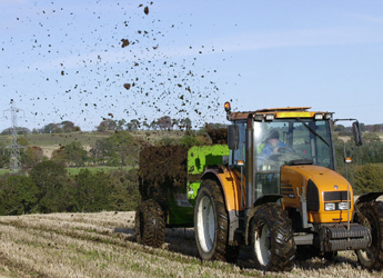 Image showing tractor and trailer carrying out muck spreading