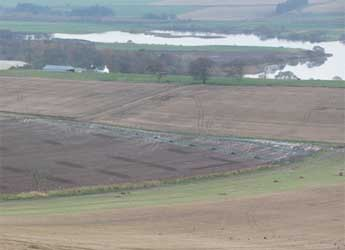 Photograph of agricultural fields alongside a river