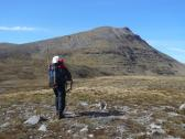 Photograph of a researcher hiking between upland soil survey locations